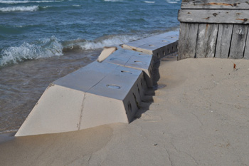 Sandsaver, Sand saver, beach erosion barrier, installed sandsavers, sandgrabber barrier, beach renourishment